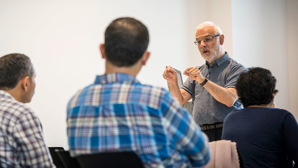 Mike Fertig teaching students in a class at the Summer School