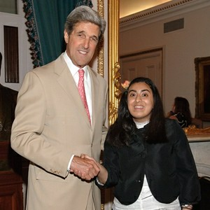 An image of Myra Chaudhary BA/MA '10 and former MA Senator John Kerry