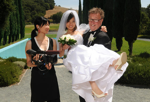 Filmmaker Lum and a white groom holding his Chinese wife