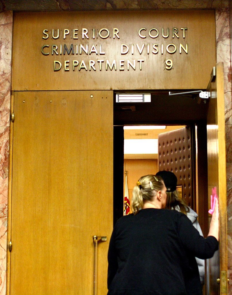 Julie Shearer, Robert Shearer's wife, and son enter the courtroom before Shearer arraignment at the Hall of Justice on Friday, April 26, 2013. Shearer is the former SF State Director of Environmental Health and Occupational Safety who plead not guilty to 128 felony charges for allegedly accepting bribes that cost the University millions. Photo by Gabriella Gamboa / Xpress