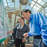 jwprc-03 -- Jennifer Schreiber '13 explains her research to Professor of Mathematics Tian Xiao-He.