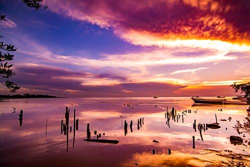ocean sea storm clouds reflection shadows dusk evening sky nikon d5200 tokina 1116mm trinidad trinidadandtobago caribbean weather