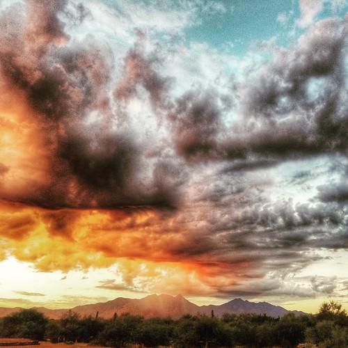 rain tease arizonasky cloudsandsky sunrise jobsite atwork atmospheric mountains santaritamountainsaz smartphonephotography sm930t red orange yellow blue