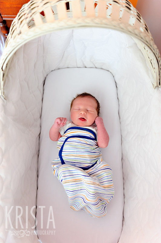 newborn baby boy in bassinet