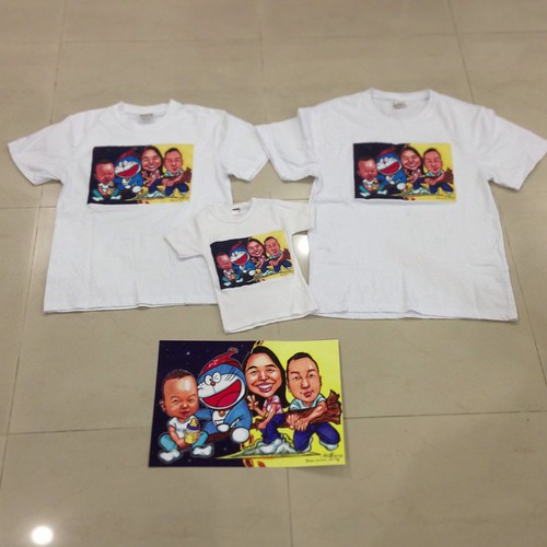 family caricatures with Doraemon printed on T-shirts
