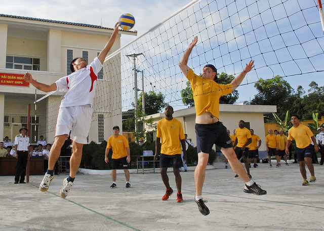 Sailors play volleyball with Vietnamese sailors.