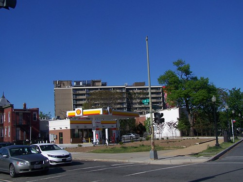 Shell Oil Station at 14th and Maryland Avenue, with Delta Towers senior housing in the background