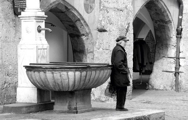 Old Woman By Fountain