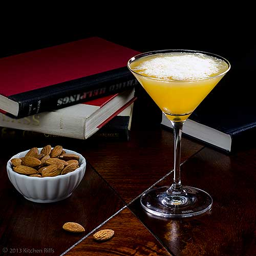 Algonquin Cocktail in Cocktail Glass with Books and Almonds in Background