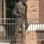 What's Your Passion? -- A statue honoring past university president Minor Meyers stands outside the Ames Library.
