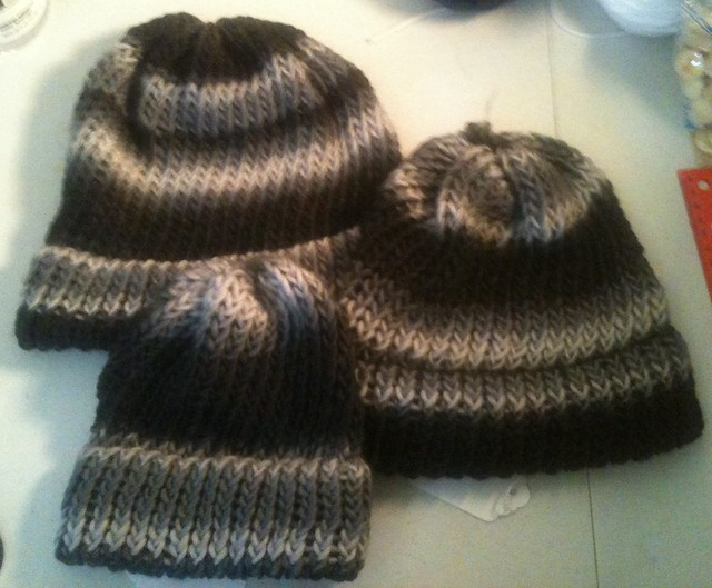 three black-white-gray wool hats