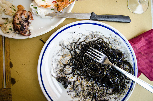 Making a mess of my squid ink spaghetti in Venice.