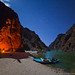 Grand Canyon river camp by moonlight, stars, and campfire