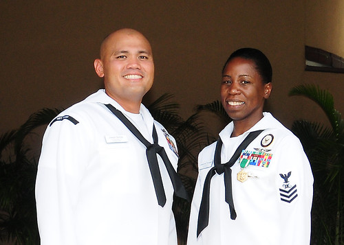 Hospital Corpsman 1st Class Joseph Santos, left, and Mass Communication Specialist 1st Class Cassandra Thompson