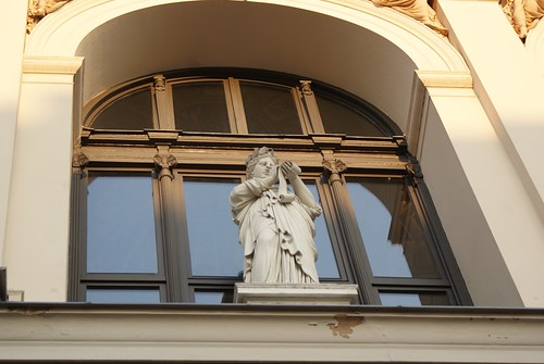 This statue is writing down all the fashion faux pas of the tourists at Musikverein