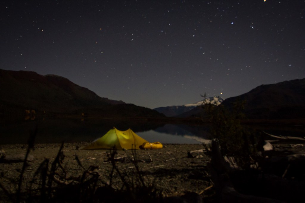 A frosty night on the shores of Lago Mascardi, which we explored on packraft. The nearby Rio Manso is so shallow this time of the year, we have to content ourselves with lakes. Cerro Tronador (3491m) dominates the lunar lit skyline. PN Nahuel Huapi. Argentina.