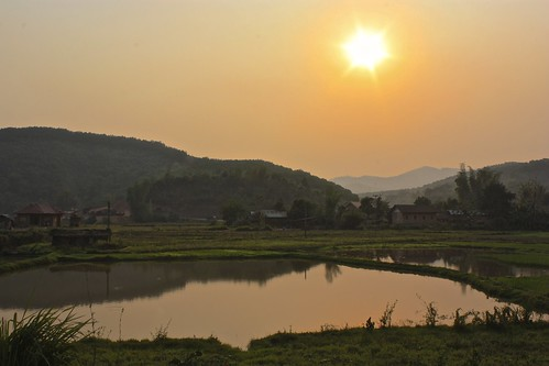 sunset over the outskirts of Nong Khiaw