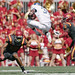 College football player jumps to avoid tackle - [Explored] by Q Win