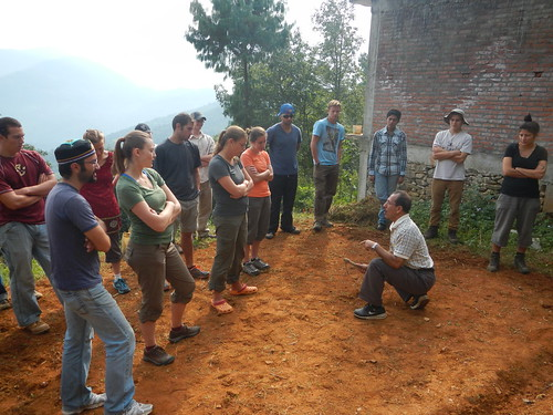 Peace Corps Volunteers gather around an instructor to learn a new agricultural practice.