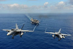 Two F/A-18E Super Hornets from the Tophatters of Strike Fighter Squadron (VFA) 14 participate in an air power demonstration over the aircraft carrier USS John C. Stennis (CVN 74), April 24 in the Pacific Ocean. (U.S. Navy Photo by Mass Communication Specialist Seaman Apprentice Ignacio D. Perez)