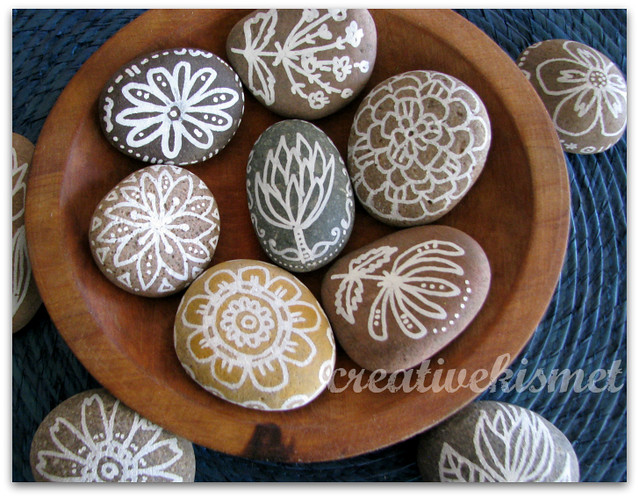 Hand painted rocks by Regina Lord