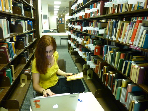 Image of graduate assistant working on weeding in the stacks