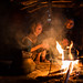 two old women Apatani get hot in front of the fire, ziro, arunachal pradesh