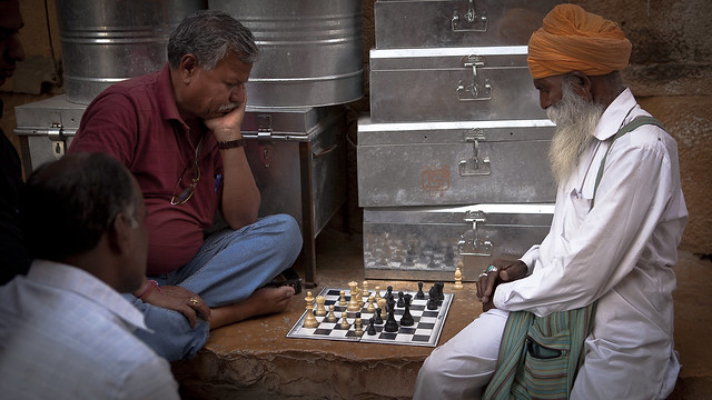 Avoid the crowd. Do your own thinking independently. Be the chess player, not the chess piece.  Street chess players - Jaisalmer, Rajasthan, India