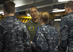In this file photo, Adm. Cecil Haney, commander of U.S. Pacific Fleet, congratulates Quartermaster Seaman Taylor Robinson after presenting her with a warfare device during a ceremony aboard the aircraft carrier USS Nimitz (CVN 68) as it transited past the Hawaiian Islands in April. (U.S. Navy Photo by Mass Communication Specialist 2nd Class Jason Behnke)