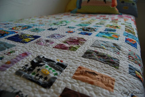 rainbow i spy quilt on bed