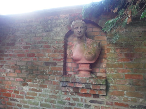 Bust on Wall along Path by Walled Garden, Lilies, Weedon