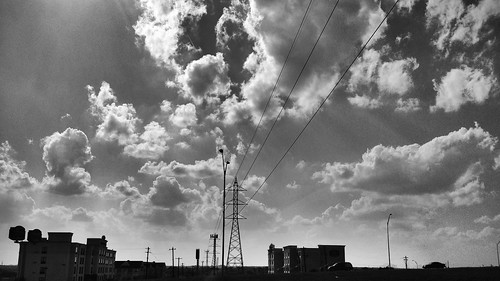 sky blackandwhite cars clouds buildings austin landscape powerlines cables electricity daytime poles uploaded:by=flickrmobile flickriosapp:filter=nofilter