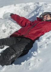ski equipment(0.0), footwear(0.0), ski(0.0), snowboard(0.0), extreme sport(0.0), winter(1.0), snow angel(1.0), snow(1.0),