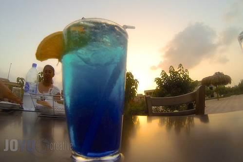 blue sunset orange woman reflection girl table drink liquid bluelagoon