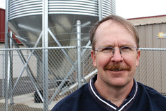 Jim Bunge in front of biomass pellet silo