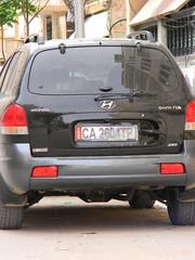 crossover suv(0.0), automobile(1.0), automotive exterior(1.0), sport utility vehicle(1.0), hyundai(1.0), vehicle(1.0), compact sport utility vehicle(1.0), bumper(1.0), land vehicle(1.0), vehicle registration plate(1.0),