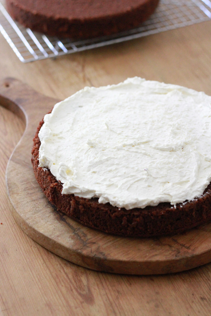 chocolate cake with whipped cream and cream cheese frosting