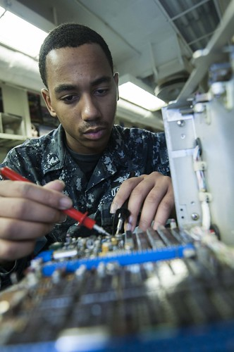 A sailor maintains avionics equipment. | by Official U.S. Navy Imagery