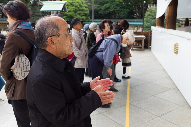 Prayers at Yasukuni Shrine. This altar is for honoring the wall dead, and is the controversial shrine honoring Japanese generals of World War II visited by the previous Japan Prime Minister.