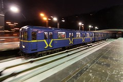 Type 'EЖ' train emerges from the tunnel at Dnipro (Днiпро) station