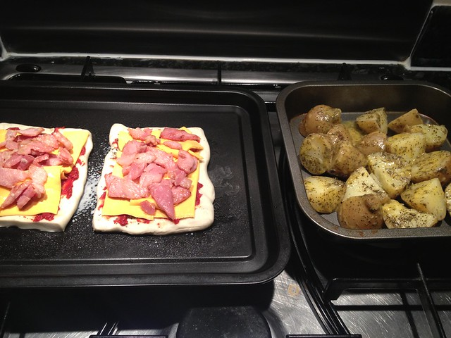Puff pastry bacon pizzas with herby roast potatoes