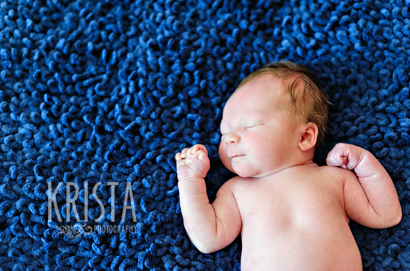 newborn baby boy on blue blanket