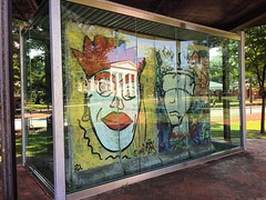 "Four sections of the historic Berlin Wall featuring graffiti art entitled ""Kings of Freedom"" by West German artist Dennis Kaum are displayed in glass in front of Alderman Library at the University of Virginia. https://news.virginia.edu/content/berlin-wall"