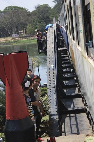 "on the ""death railway"" going over the bridge over River Kwai. The beginning of the bridge is marked by a WWII era bomb on either side."