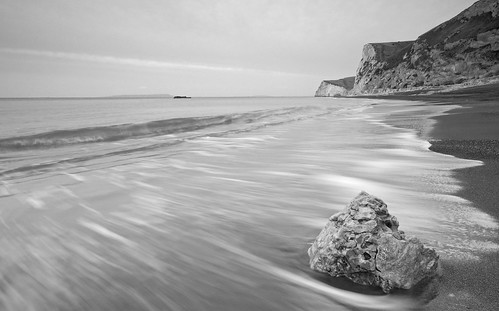 light sea beach water sunrise coast chalk sand rocks waves peaceful cliffs dorset jurrasic durdledoor