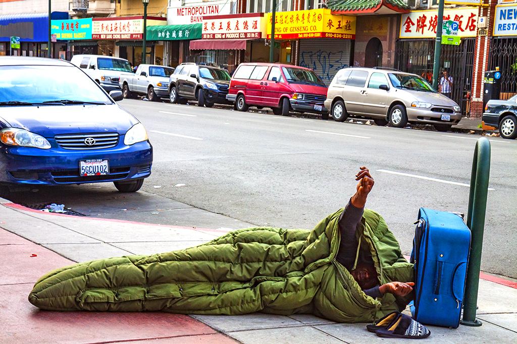Man-waking-up-on-Chinatown-sidewalk--Oakland