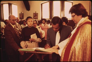 Black Family Signing The Church Registry At The Church Of The Messiah After The Baptism Of Babies In The Congregation. On The South Side Of Chicago, 08/1973