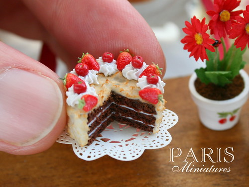 Chocolate cake decorated with cherries, strawberries and Chantilly cream - Miniature Food