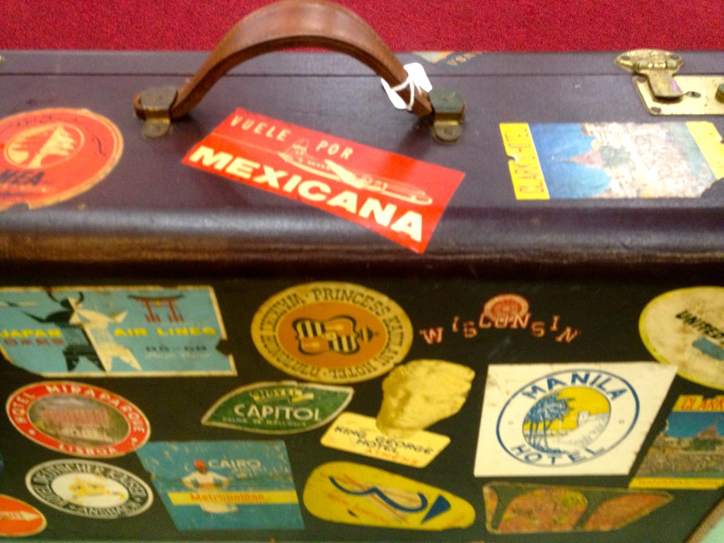 stock Vintage Leather Suitcase w Travel Stickers