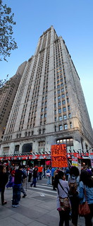 vert. panorama: Occupy Wall St. protesters at the foot of the Woolworth Building